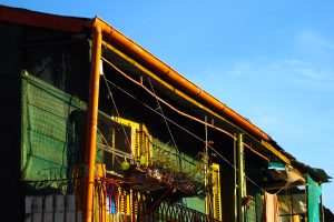 A colorful balcony at sunset in the 'La Boca' neighborhood of Buenos Aires, Argentina.