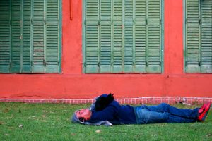 A man sleeps with a cat on his chest near a shuttered building at the famously cat-ridden Buenos Aires Botanical Garden in the Palermo neighborhood of Buenos Aires, Argentina.