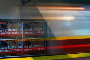 A metro train blurs as it leaves a station in Buenos Aires, Argentina.