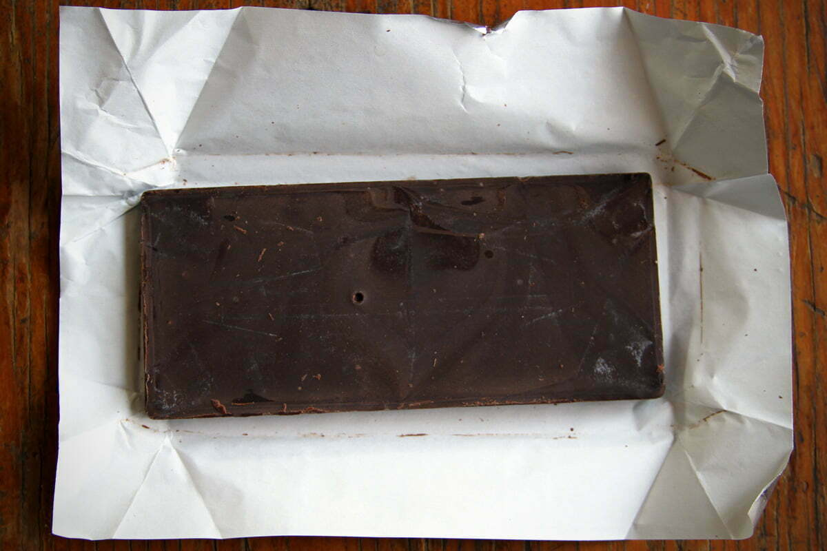 An unwrapped bar of chocolate as seen from above