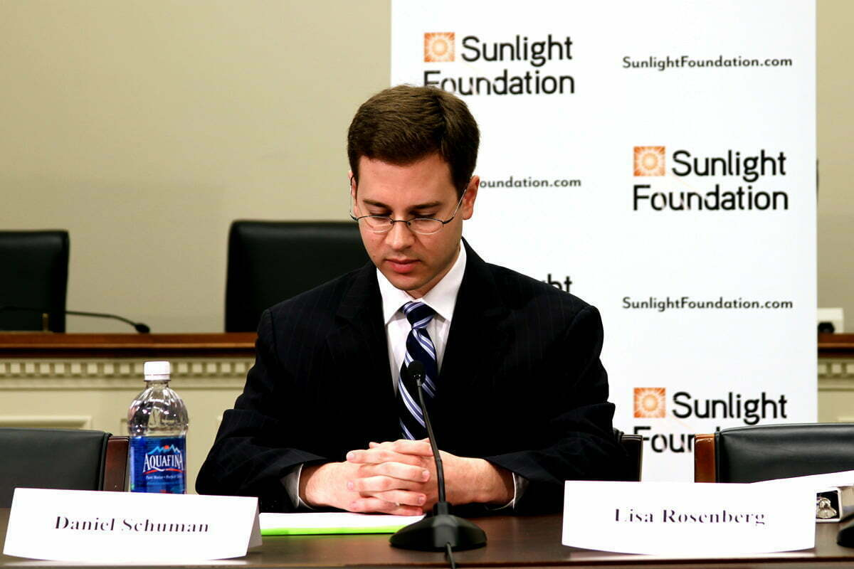 Daniel Schuman sits at an ACT event and prepares remarks.