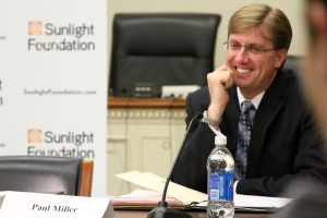 Paul Miller smiles as he joins a panel discussion on the Hill.