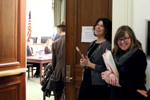 Two smiling Sunlight employees welcome folks to the ACT event on Capitol Hill.