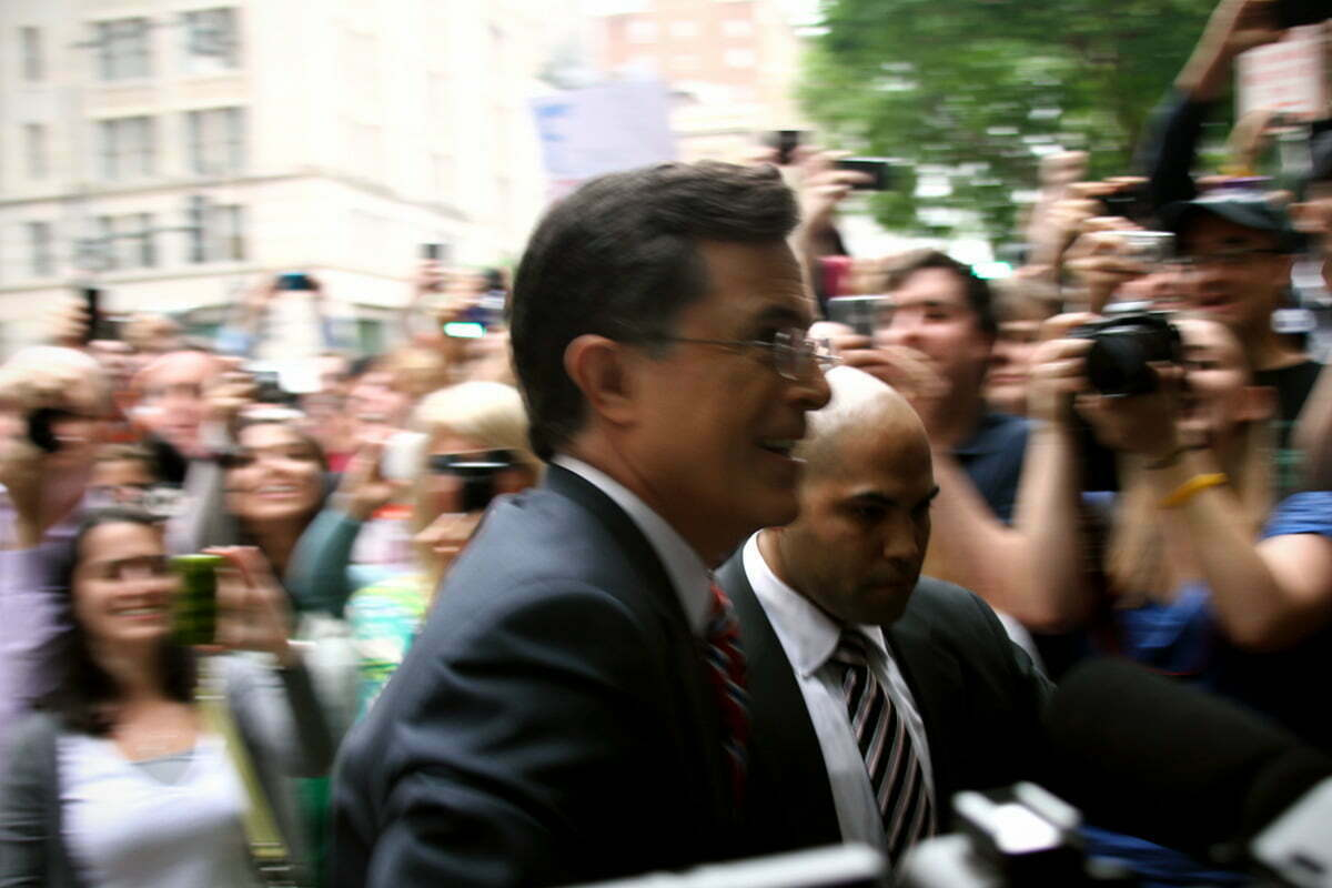 Colbert Show host Steven Colbert moves through the crowd as he enters the FEC headquarters in Washington DC.