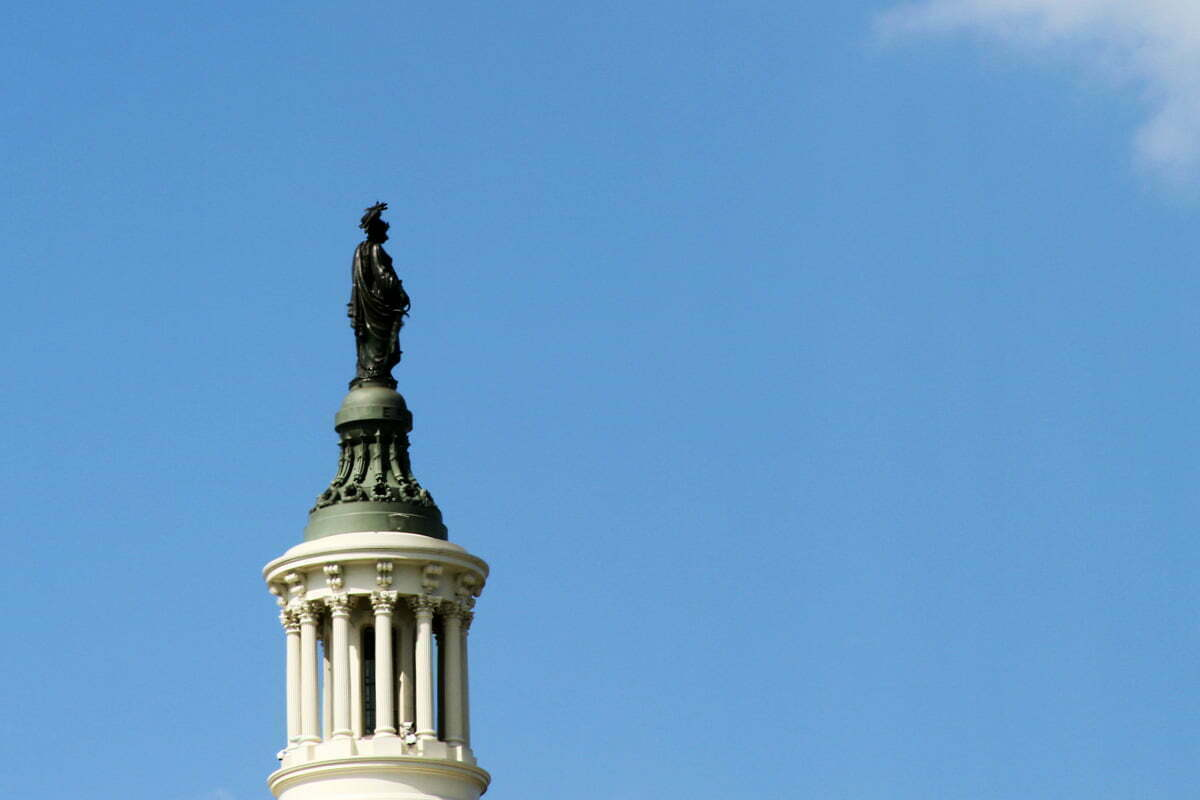 A closeup image of the statue on the top of the US Capitol