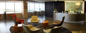 A panorama of the 7th floor lobby in Microsoft's DC office with a desk and office chairs in a circle.