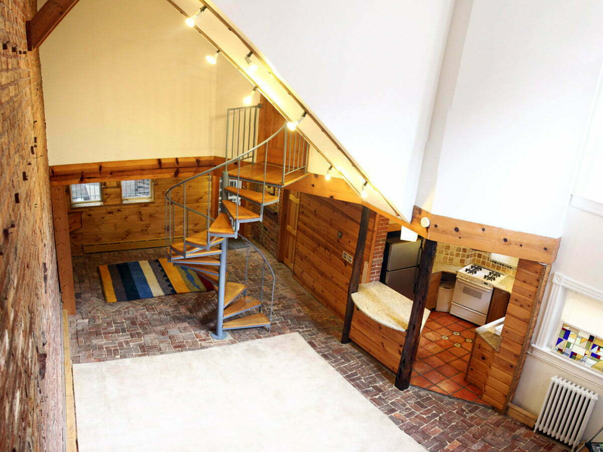 The finished panorama of the basement apartment in June.