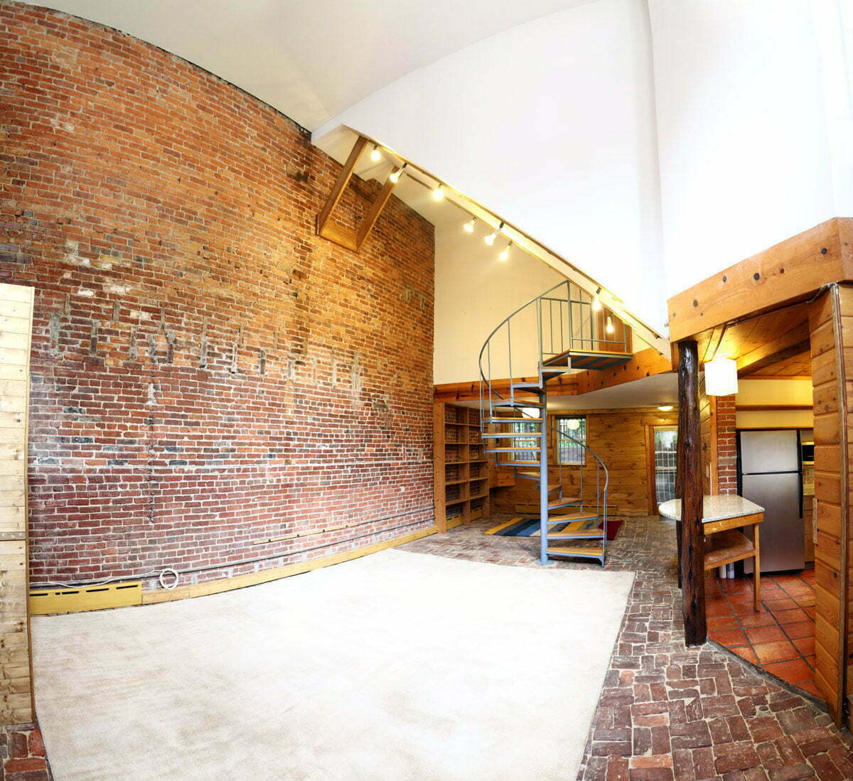 A panoramic photograph of a large loft basement apartment in Washington DC.