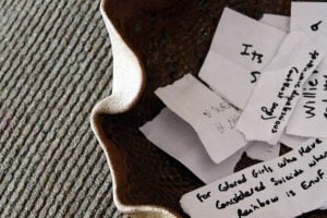 A handmade piece of pottery contains the phrases for a past game of charades.
