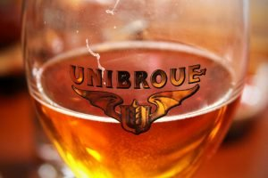 A glass of Unibroue, a Canadian Belgian-style beer.