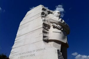 """A view up to the statue of Martin Luther King Junior with the inscription, """"Out of the mountain of despair, a stone of hope."""""""