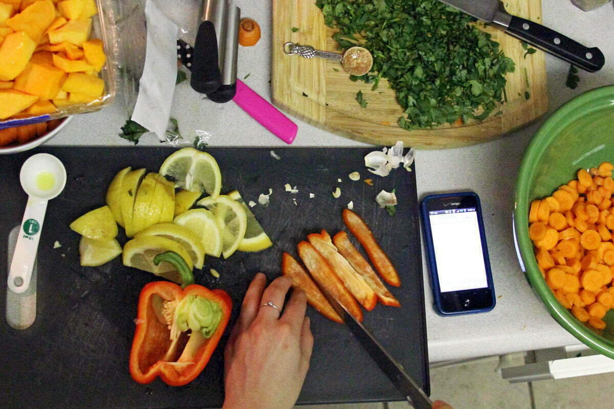 A top down view of Sally preparing various ingredients for the blog, My Daughter's Kitchen.
