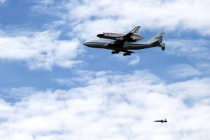 NASA's space shuttle discovery flies over the Washington DC area on the 747 Shuttle Carrier Aircraft before landing at Dulles International Airport to be stored at the Smithsonian's Udvar-Hazy Center.