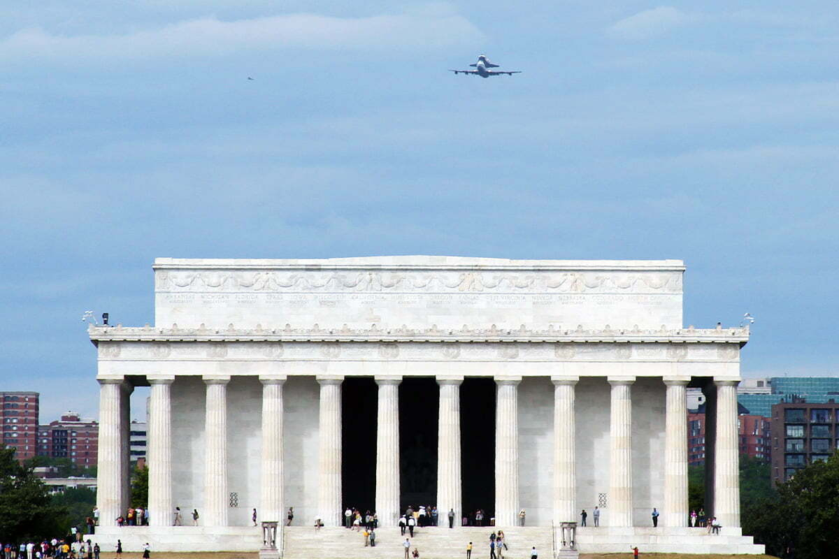 The space shuttle Discovery does a fly by over the Lincoln Memorial in Washington DC before being retired.