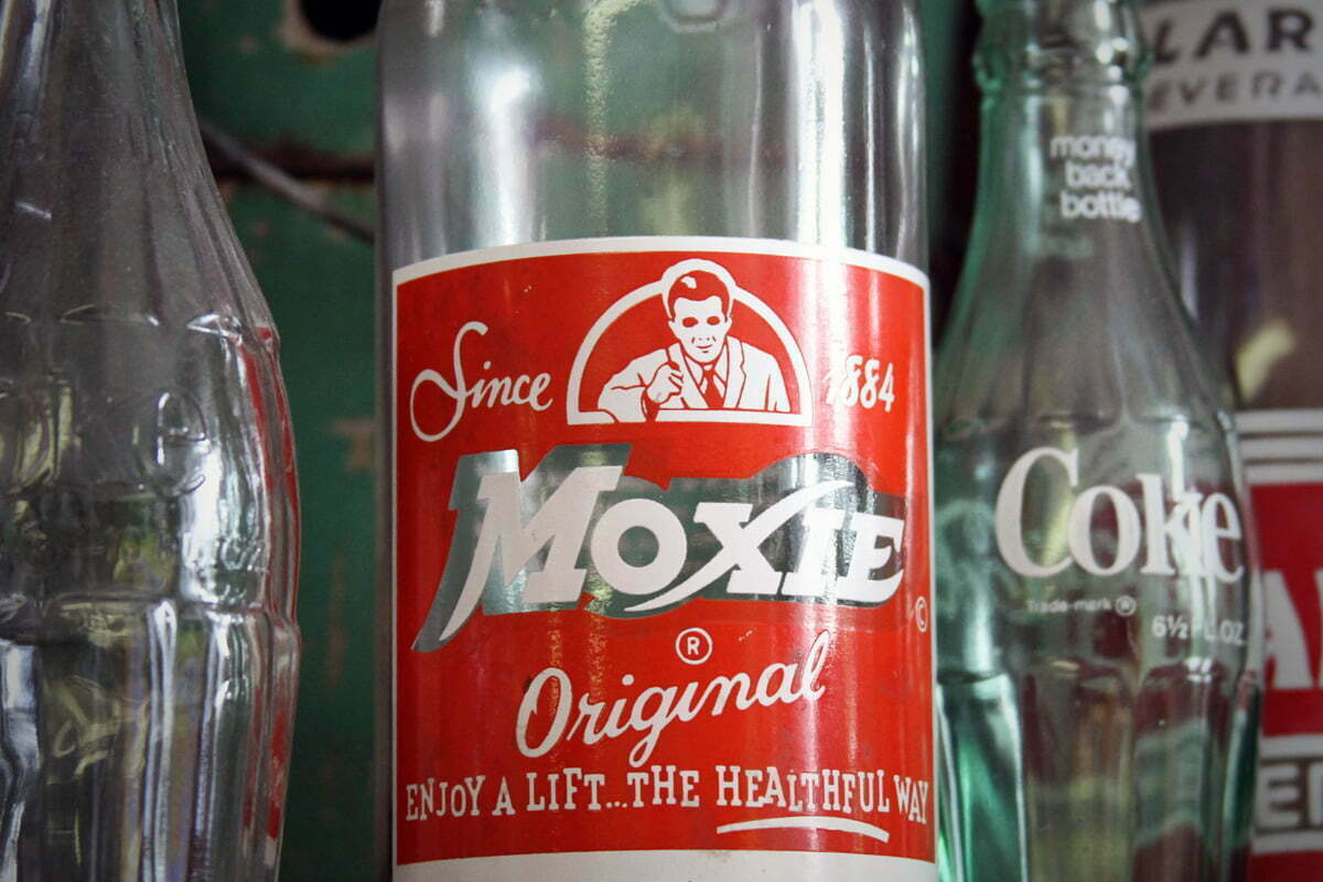 An old glass bottle of the official soft drink of Maine, Moxie Original.