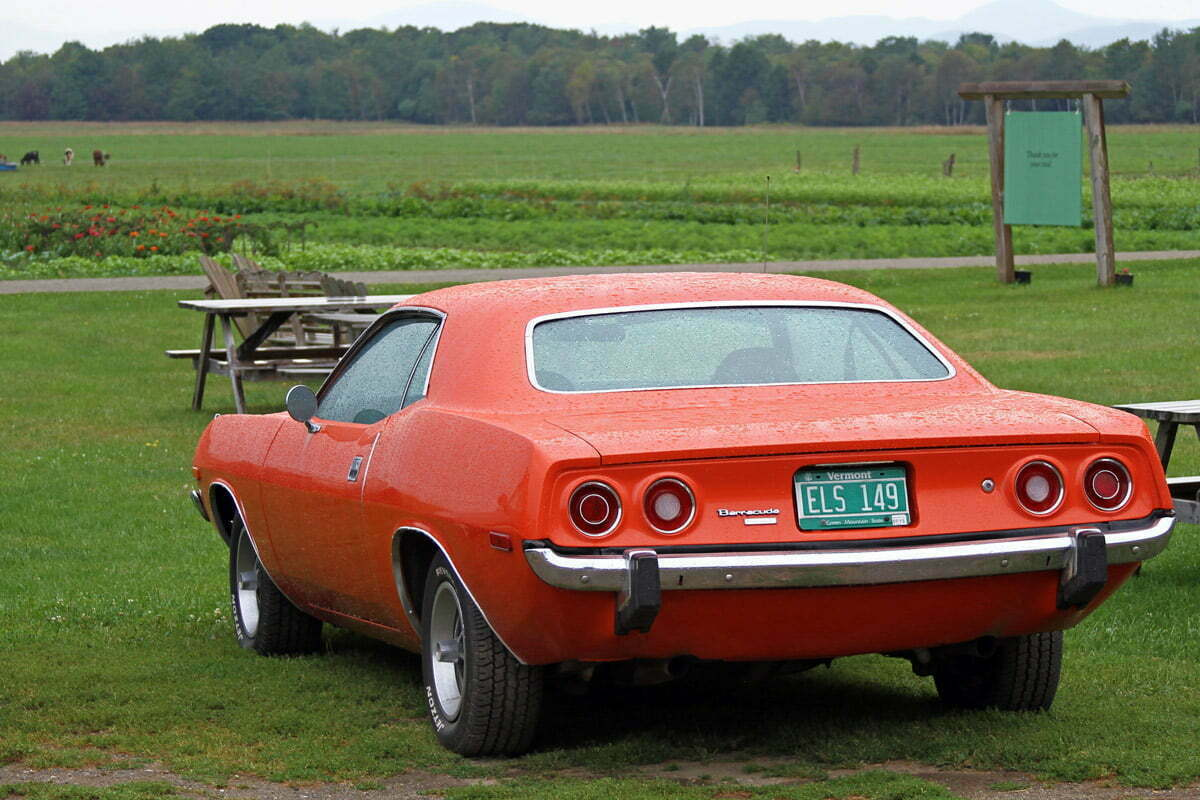 A 1972 Plymouth Barracuda sits parked in the Vermont Rain.