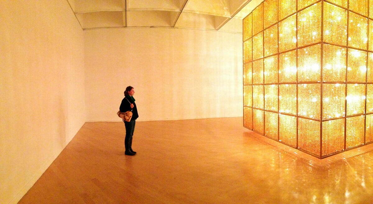 "Sara standing in front of ""Cube Light"" by artist Ai WeiWei in Washington D.C. at the Smithsonian's Hirshhorn Museum."