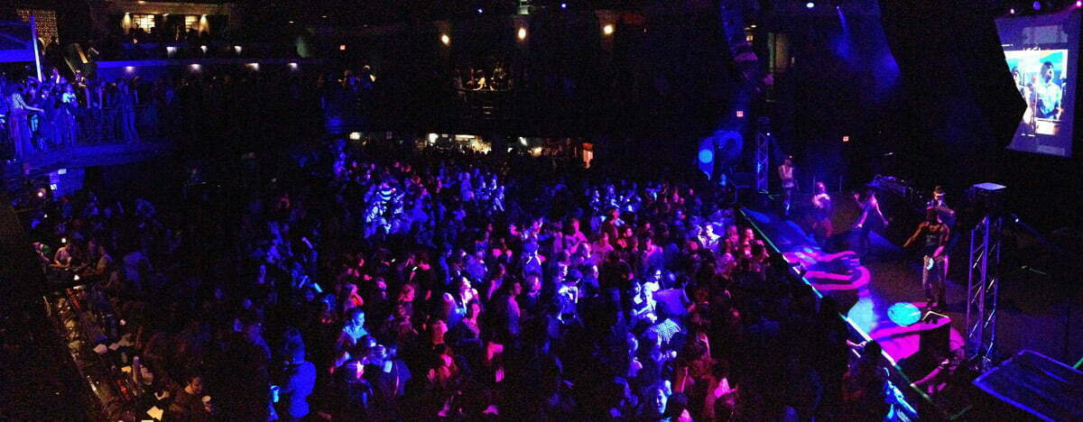 A panoramic photo of a dance party at the 9:30 Club in Washington DC.