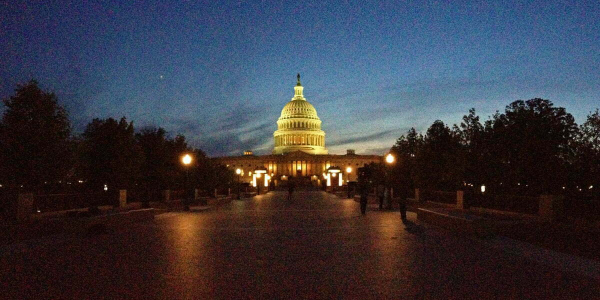 The United States Capitol Building seen at dusk on a spring evening in Washington DC.