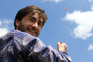 My friend Leo flies a kite at the Cherry Blossom Kite Festival near the Washington Monument in Washington D.C.