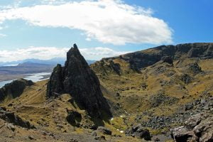 A panoramic view of the mountains and landscape seen from a hike to Old Man of Storr in Isle of Skye, Scotland.