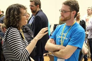 A tcamper talks to a camp counselor following the opening session of TransparencyCamp 2013.