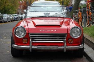 The front grill and headlights on a red 1967 Datsun 1600 Roadster - my favorite car.