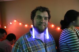 Zander wearing glow stick earrings at the going away party for Eric at the Sunlight Foundation.