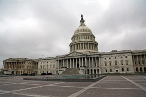 The U.S. Capitol Building on a cloudy day with no people in sight in Washington D.C.