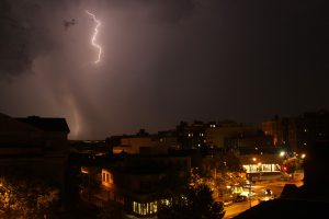 A lightning bolt strikes in the distance during a heat lightning storm in Washington DC.