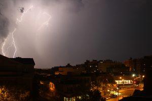 A huge bolt of lightning strikes during a heat storm over Adams Morgan in Washington DC.