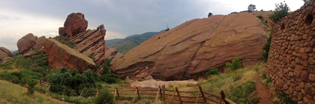 A panoramic photo of the dramatic sandstone outcroppings on a hike in Red Rocks Park near Denver, Colorado.