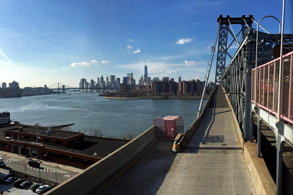 A view of Lower Manhattan on a clear day seen from the Williamsburg Bridge.