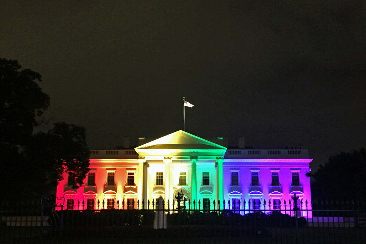 A photo of the White House illuminated with Rainbow Flag colored lights in honor of the Supreme Court decision supporting gay rights and marriage.