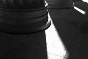 Sunlight casts long shadows through columns at the Philadelphia Museum of Art.