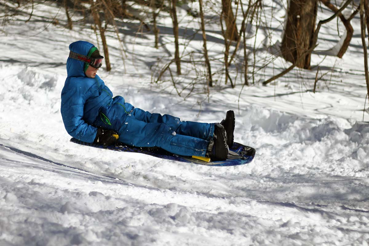 A young sledder braces for impact while airborne  in Washington DC during Winter Storm Jonas, also known as Snowzilla.