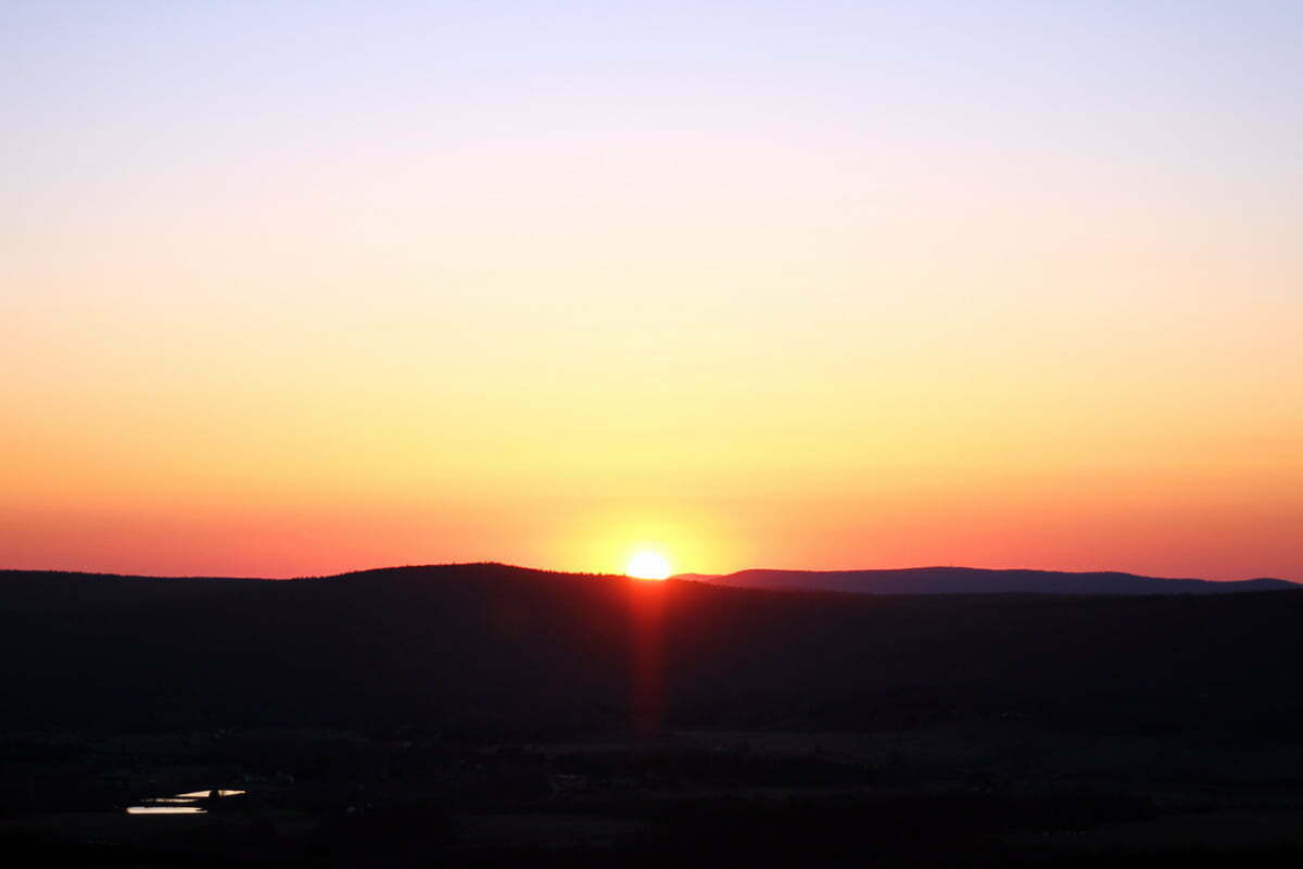 A gradient of sky from blue to red during a sunset in Canaan Valley, West Virginia.