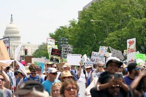 Thousands of protesters walk down Pennsylvania Avenue away from the US Capitol at the People's Climate March.