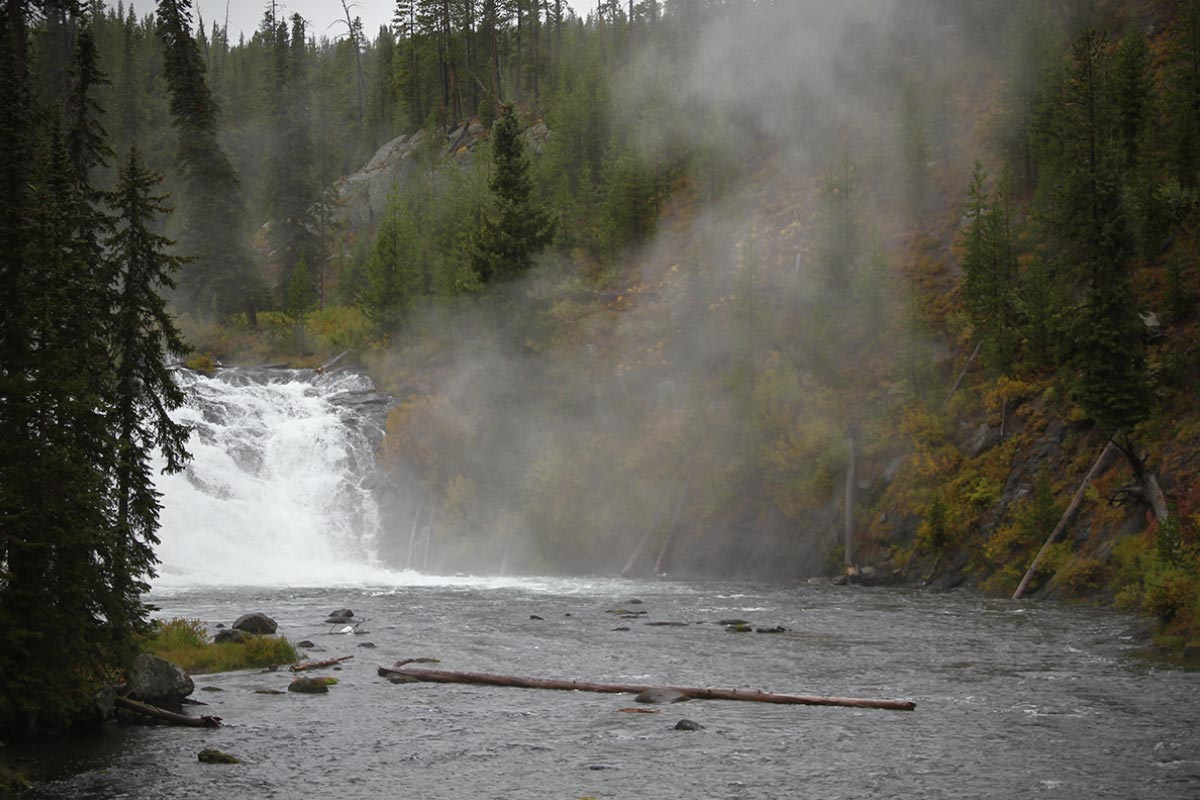 Mist rises from a waterfall at Grand Teton National Park in Wyoming.