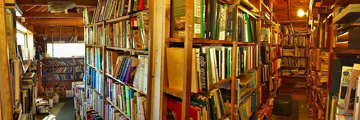 A panoramic view down two of the packed stacks of used book in the Lobster Lane Book Shop in South Thomaston, Maine.