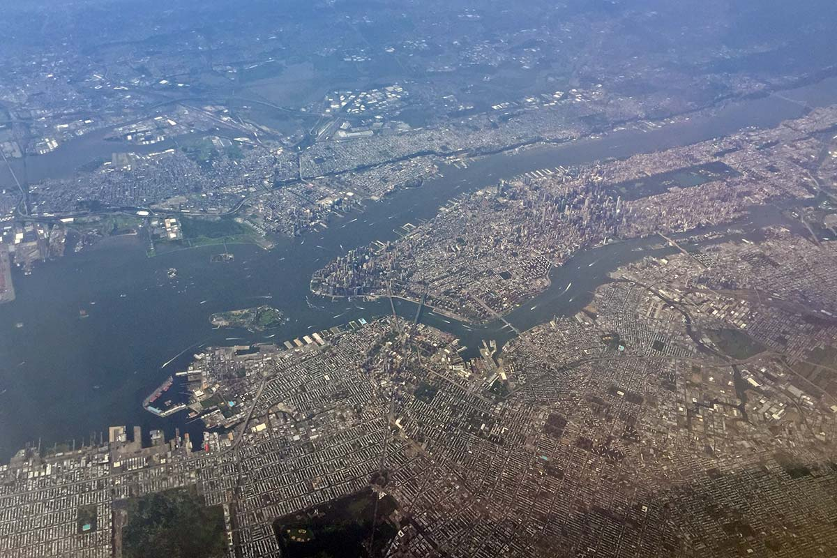 A view over New York City taken from an airplane on a clear day.
