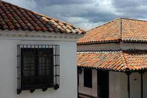The tiled rooftops, windows and patio of the Botero Museum in Bogota, Colombia.