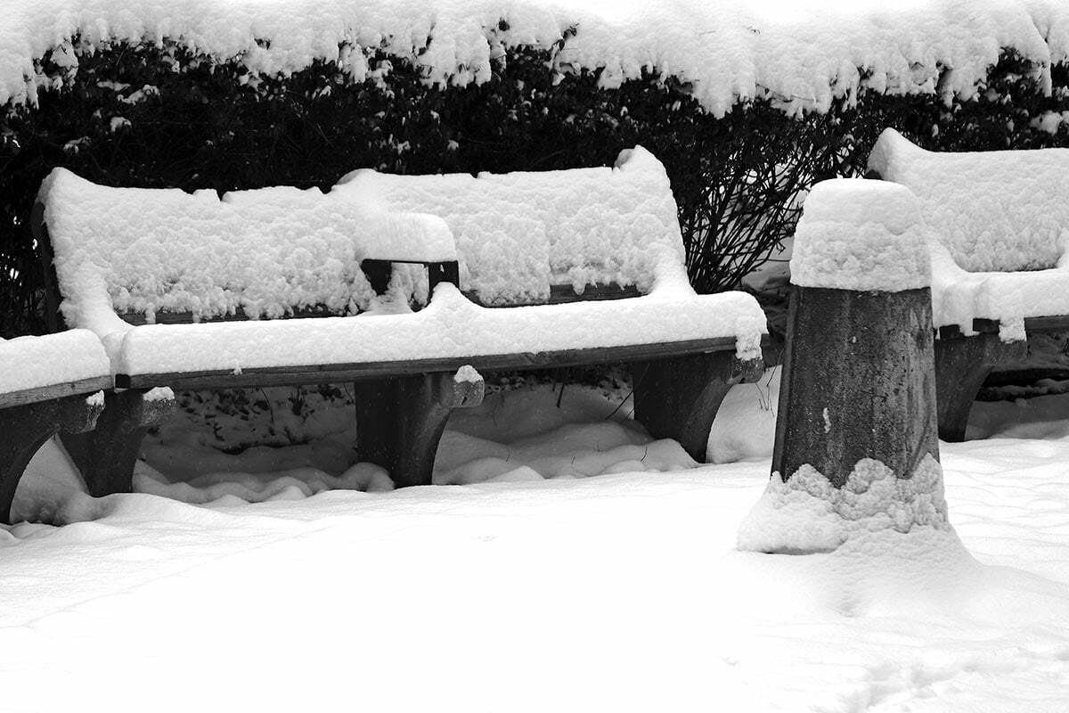 Some park benches and a water fountain covered in snow seen near Kalorama Park in Washington DC.