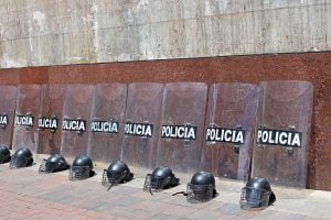 Riot police helmets and shields lay against a wall before a protest in Bogota, Colombia.