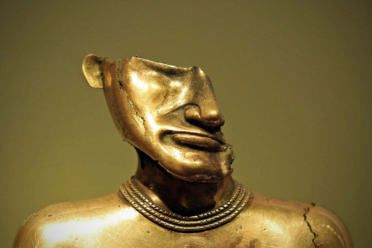 The broken head of a female poporo made of gold, seen in the Museum of Gold in Bogotá, Colombia.