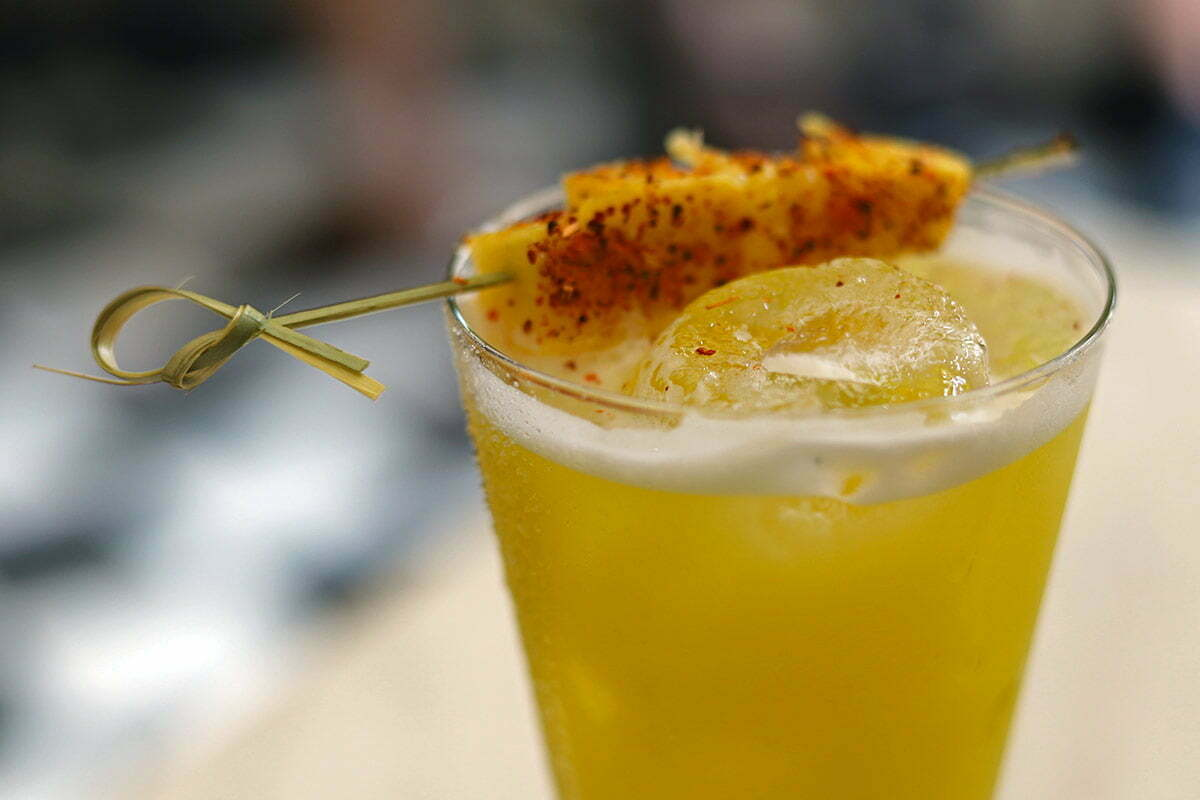 A spicy mezcal cocktail with pineapple, spices and ginger syrup seen in the Old Walled City of Cartagena, Colombia.