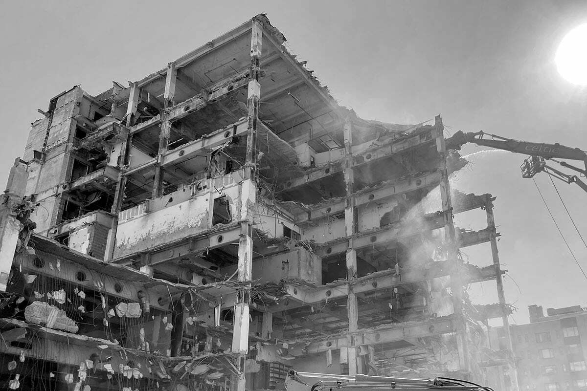 A black and white photo of a demolition crew tearing down the old Australian Embassy at Scott Circle in Washington, DC.